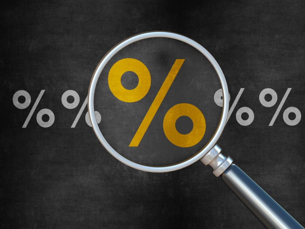 percent sign under magnifying glass