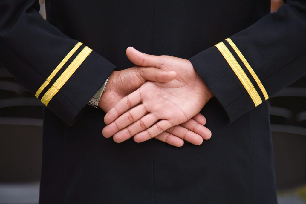 naval recruit hands folded
