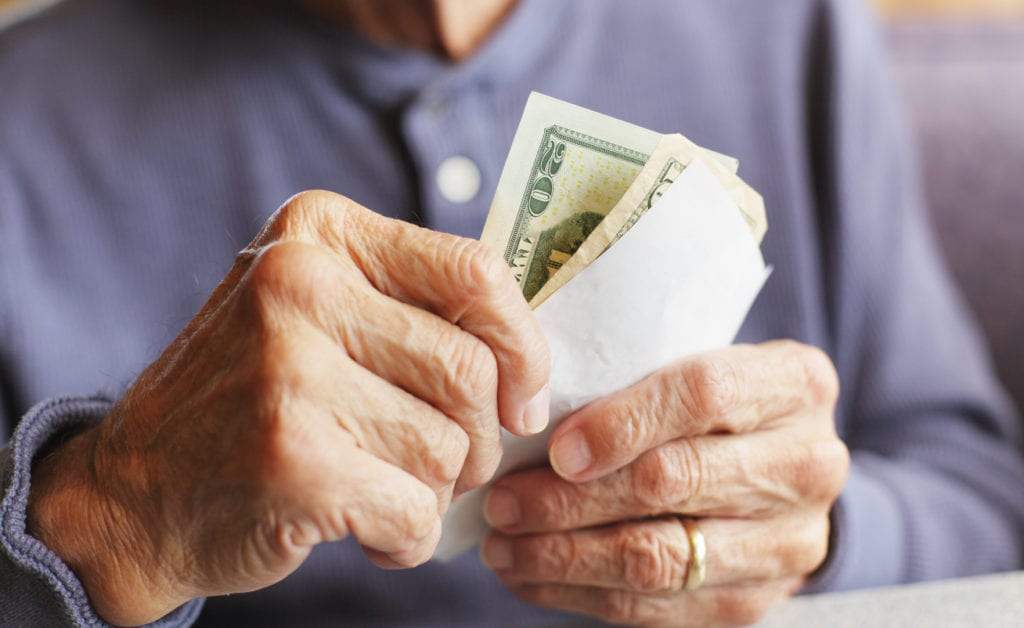 senior man holding money